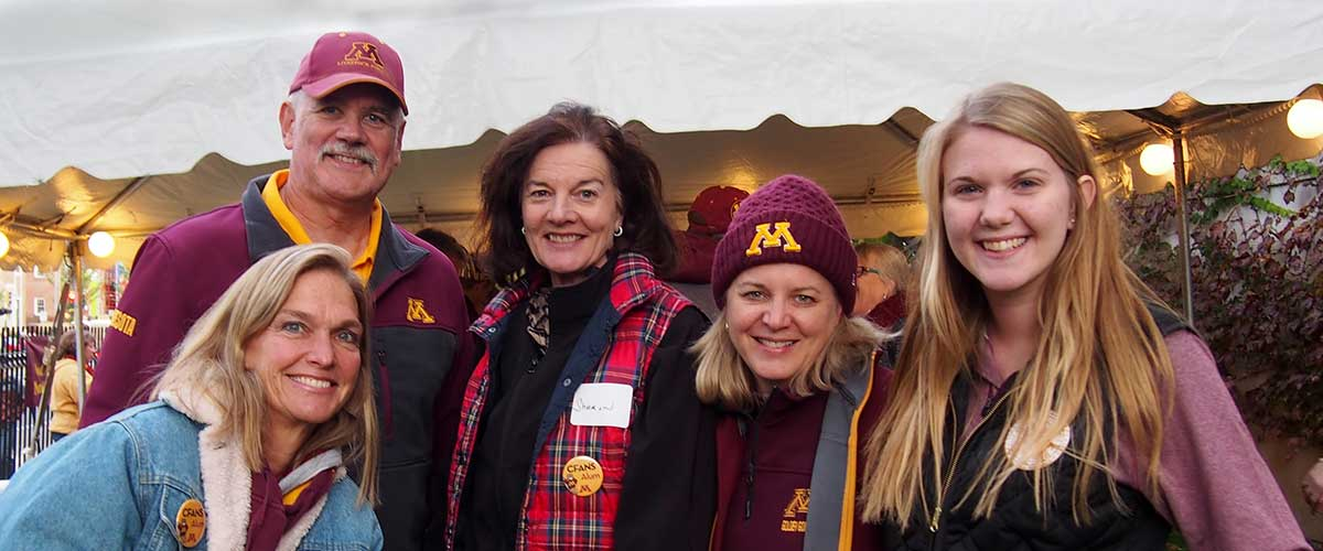 5 CFANS alumni in gopher gear stand together