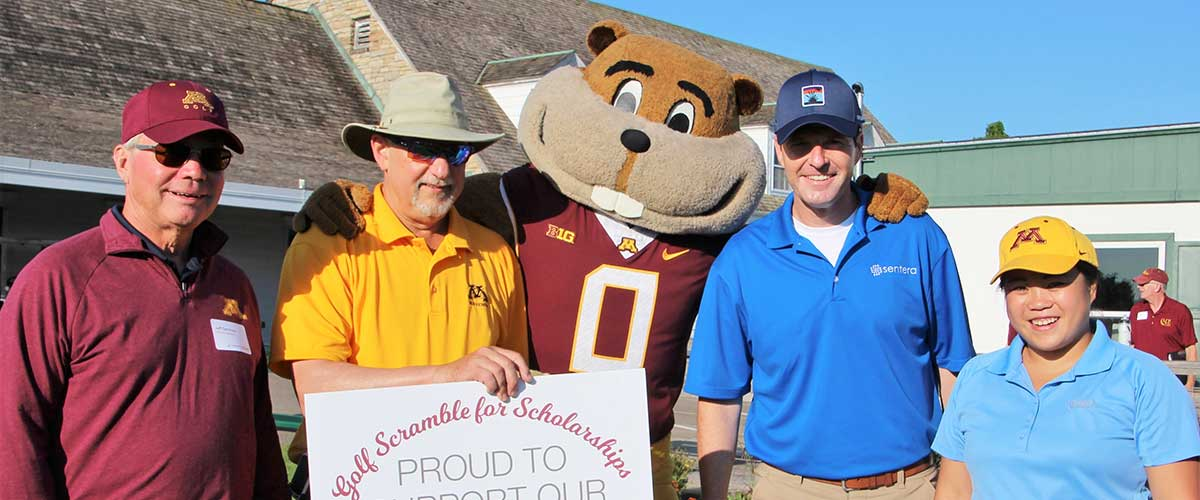 4 CFANS supporters stand with Goldy gopher