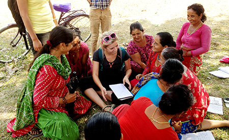 Student talks with local women in Nepal
