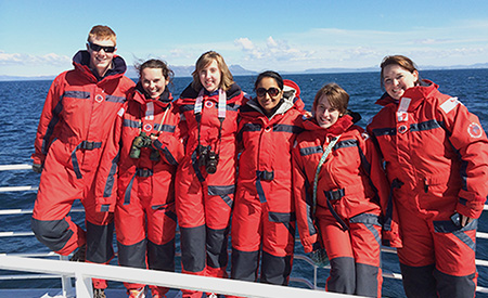 Six students aboard a whale watching boat in Iceland