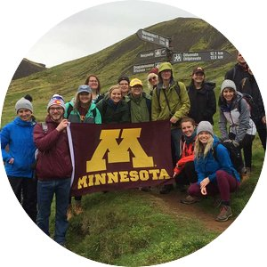 Group of students with a Minnesota flag in Iceland.