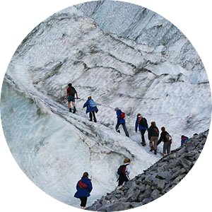 Students hiking in New Zealand up a rocky, icy mountain
